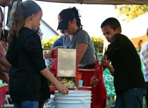 Children pressing cider at 2013 Harvest Festival (Photo: Jen Myers)